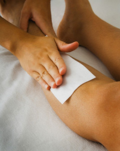 Close up of woman's leg being waxed